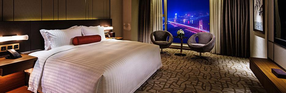 南昌瑞颐大酒店豪华套房卧室